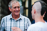 Portland mayor Charlie Hales chatting at Alley33 Fashion Event.