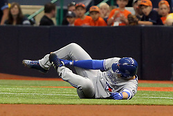 May 6, 2018 - St. Petersburg, FL, U.S. - ST. PETERSBURG, FL - MAY 06: Aledmys Diaz (1) of the Blue Jays is holding his left foot after he went to the ground after safely running to first base during the MLB regular season game between the Toronto Blue Jays and the Tampa Bay Rays on May 06, 2018, at Tropicana Field in St. Petersburg, FL. (Photo by Cliff Welch/Icon Sportswire) (Credit Image: © Cliff Welch/Icon SMI via ZUMA Press)