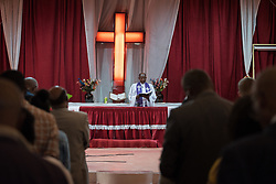 27 October 2019, Addis Ababa, Ethiopia: Rev. Tekle Ayele presides at Sunday service at the Finfinne Oromo Mekane Yesus Congregation of the Ethiopian Evangelical Church Mekane Yesus. In a context where congregations did not use to be allowed to hold their services in any language but Amharic, the congregation today is one of some 60 Oromo speaking Mekane Yesus congregations in Addis Ababa. The service takes place on the first Sunday following political turmoil in the country, claiming dozens of lives.