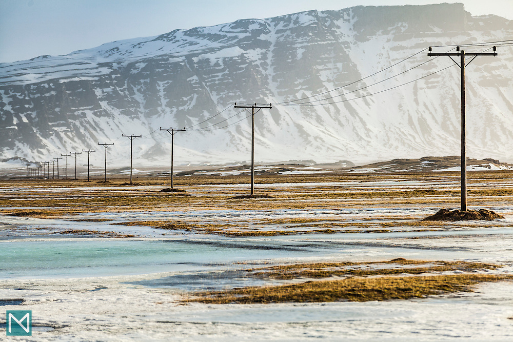 Telegraph poles in formation in the middle of the Icelandic countryside
