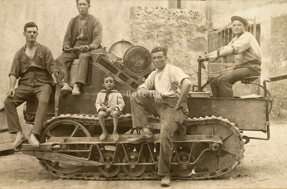 farmer showing proudly his caterpillar tractor 1920s France
