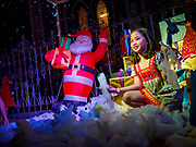"""23 DECEMBER 2018 - CHANTABURI, THAILAND: Children for photos with Santa in the """"North Pole"""" at the Cathedral of the Immaculate Conception's Christmas Fair in Chantaburi. Cathedral of the Immaculate Conception is holding its annual Christmas festival, this year called """"Sweet Christmas @ Chantaburi 2018"""". The Cathedral is the largest Catholic church in Thailand and was founded more than 300 years ago by Vietnamese Catholics who settled in Thailand, then Siam.   PHOTO BY JACK KURTZ"""