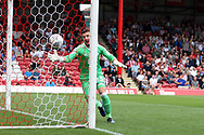 Jordan Smith , the Nottingham Forest goalkeeper tries in vain to keep out the header from John Egan of Brentford (not in pic) who scores his teams first goal.  EFL Skybet football league championship match, Brentford  v Nottingham Forest at Griffin Park in London on Saturday 12th August 2017.<br /> pic by Steffan Bowen, Andrew Orchard sports photography.