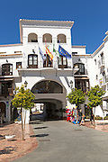 Flags flying on town hall Ayuntamiento building, Nerja, Malaga province, Spain