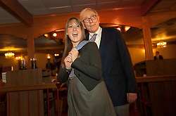 Warren Buffett poses with business students from universities around the country after at lunch at Piccolo Pete's Restaurant in Omaha, Neb., Nov. 11, 2011. Here, Buffett poses with Stephanie Vogel of Gonzaga University.