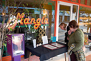 Hungry tourists perusing the Mangia restaurant menu on Corey Avenue.  St. Pete Beach Tampa Bay Area Florida USA