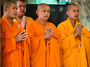 21 AUGUST 2015 - BANGKOK, THAILAND: Mahayana Buddhist monks lead a ceremony to restore the Erawan Shrine after the bombing. The Bangkok Metropolitan Administration (BMA) held a religious ceremony Friday for the Ratchaprasong bomb victims. The ceremony started with a Brahmin blessing at Erawan Shrine, which was the target of a bombing Monday night. After the blessing people went across the street to the plaza in front of Central World mall for an interfaith religious service. Theravada Buddhists, Mahayana Buddhists, Muslims, Sikhs, Hindus, and Christians participated in the service. Life at the shrine, one of the busiest in Bangkok, is returning to normal. Friday the dancers and musicians who perform at the shrine resumed their schedules.       PHOTO BY JACK KURTZ