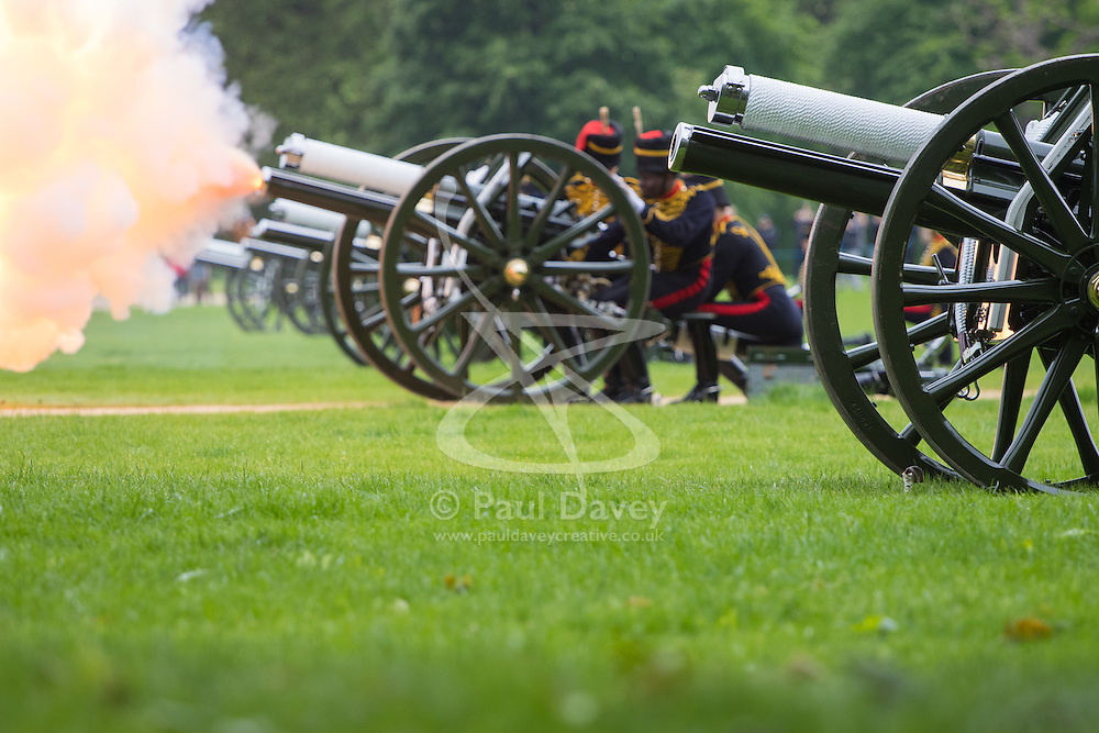 Hyde Park, London, June 2nd 2016. Soldiers and guns of the King's Troop Royal Horse Artillery fire a 41 round Royal Salute to mark the 63rd anniversary of the coronation of Britain's Monarch HM Queen Elizabeth II. PICTURED: A gun spews fame as it fires.