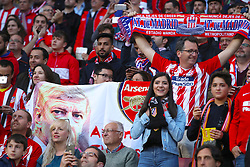 Arsenal fans hold a banner with Arsenal manager Arsene Wenger on during the UEFA Europa League, Semi Final, Second Leg at Wanda Metropolitano, Madrid.