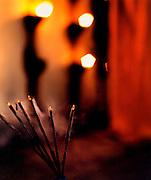 Incense sticks burning in a Hindu temple, Kerala, India