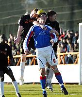 Photo: Chris Ratcliffe.<br />Barnet FC v Carlisle United. Coca Cola League 2. 25/02/2006.<br />Barnet's Nicky Bailey (L) and Adam Gross (R) close down Derek Holmes of Carlisle.