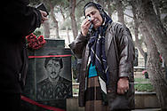Mother at the grave of her son who was killed in the Nagorno Karabakh War. Baku. 2006.