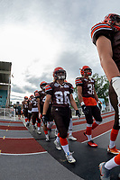 KELOWNA, BC - AUGUST 17:   Kaden Cretney #86 and Mitch Walz #31 of Okanagan Sun walk to the field against the Westshore Rebels at the Apple Bowl on August 17, 2019 in Kelowna, Canada. (Photo by Marissa Baecker/Shoot the Breeze)