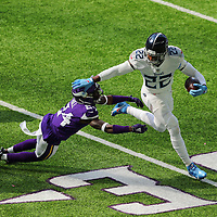 MINNEAPOLIS, MN - SEPTEMBER 27: Derrick Henry #22 of the Tennessee Titans stiff arms Holton Hill #24 of the Minnesota Vikings in the first quarter at U.S. Bank Stadium on September 27, 2020 in Minneapolis, Minnesota. (Photo by Adam Bettcher/Getty Images) *** Local Caption *** Derrick Henry; Holton Hill