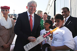 © Licensed to London News Pictures. 30/7/2013. Prime Minister Kevin Rudd signs a cricket bat for young cricket fans during the official launch of the I.C.C Cricket World Cup to be held in Australia and New Zealand in 2015, Melbourne, Australia. Photo credit : Asanka Brendon Ratnayake/LNP
