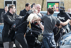 © Licensed to London News Pictures. FILE PICTURE DATED 14/04/2018 of LUCY BROWN (centre-left having her hair pulled by anti fascist protesters ) outside a Generation Identity conference in Sevenoaks in Kent . Brown has spoken out about her time as an assistant to Tommy Robinson (real name Stephen Yaxley-Lennon ) . Photo credit: Joel Goodman/LNP