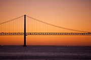 Dawn at the Ponte 25 de Abril, the 25th of April Bridge, which crosses the Tagus River in Lisbon, Portugal