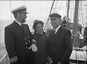 Round Europe Yacht Race.   (R61)..1987..25.07.1987..07.25.1987..25th July 1987..President Patrick Hillery started the Round Europe Yacht Race which began at Dun Laoghaire today...Image shows Captain Tom McCarthy, STV Asgard ll,Mrs Breda Saunders McCarthy and President Hillery aboard the Asgard ll.