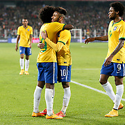 Brazil's Neymar JR (C) celebrate his goal with team mate during their a international friendly soccer match Turkey betwen Brazil at Sukru Saracoglu Arena in istanbul November 12, 2014. Photo by Aykut AKICI/TURKPIX