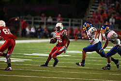 26 September 2009: Geno Blow cuts back to take advantage of a block by Tyrone Walker.  Blow is pursued by Chris Johnson (43) and Derek Domino (39). South Dakota State Jackrabitts jump past the Illinois State Redbirds 38 - 17 at Hancock Stadium on campus of Illinois State University in Normal Illinois