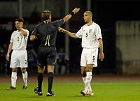 Photo: Richard Lane.<br />Croatia v England. UEFA European Championships 2008 Qualifying. 11/10/2006. <br />Referee, Roberto Rosetti books England's Rio Ferdinand.