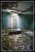 Bath in an abandoned manor house, with ladders