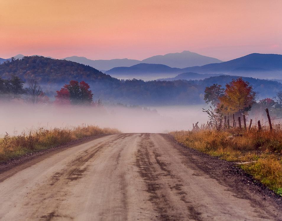 Dodd Road, foggy hills & dirt road, view Mt Mansfield & Black Creek Valley, Fairfield, VT