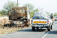 Burnt out vehicle along the route of the Save police convoy, Inhambane Province, Mozambique