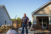 BIRMINGHAM, AL – AUGUST 31, 2015: Volunteers and professionals work together to complete homes for new homeowners in a Habitat for Humanity blitz.