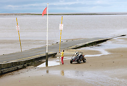 © Licensed to London News Pictures. 20/08/2012. Burnham-on-Sea, Somerset, UK.  Coastguard on the jetty at the sea front where a 4 year old boy fell off the beach jetty on Sunday night.  Emergency services are now working on the basis of recovering a body. The area has one of the highest tidal ranges in the world with strong currents especially around the jetty.  20 August 2012..Photo credit: Simon Chapman/LNP