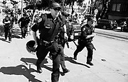 08262017 - San Francisco, California, USA:  Police run to surround counter-protesters who filled the streets around Alamo Square Park where members of the alt-right group Patriot Prayer were supposed to hold a press conference after Saturday's rally at Crissy Park but was canceled due to safety concerns.