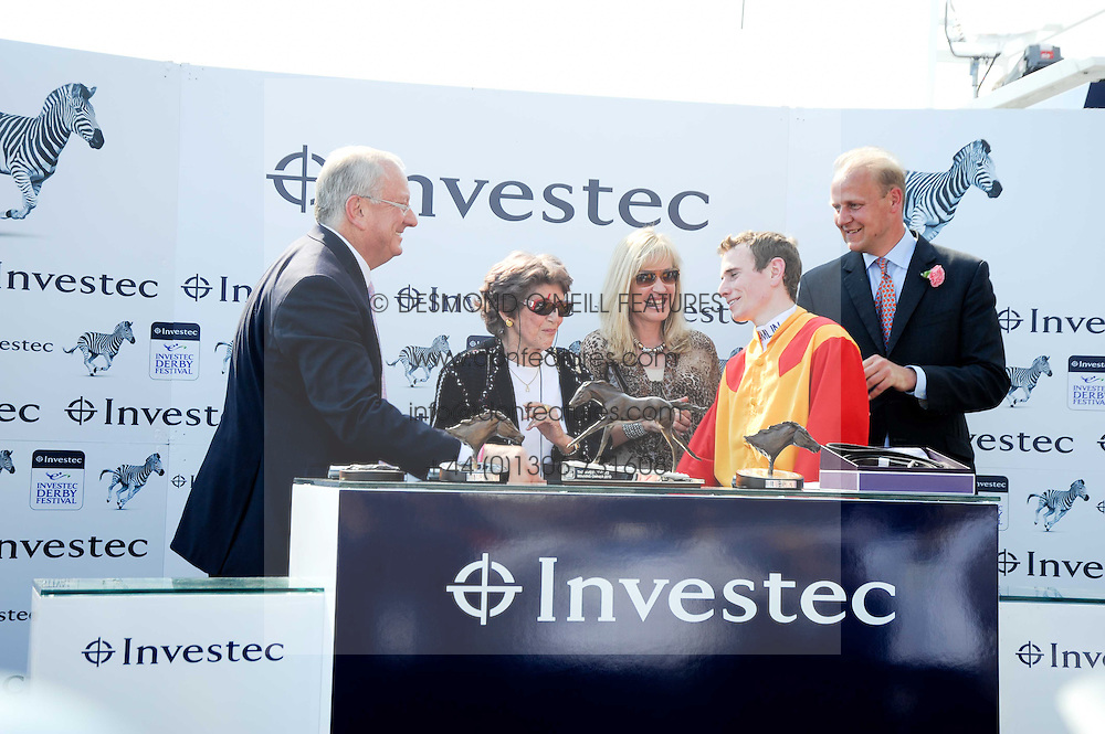 Left to right, BERNARD KANTOR CEO of Investec, CRISTINA PATINO winning owner of Snow Fairy, DALE KANTOR, trainer EDWARD DUNLOP and jockey RYAN MOORE at the Investec Ladies Day at Epsom Racecourse, Surrey on 4th June 2010.