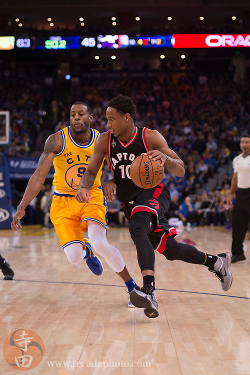 November 17, 2015; Oakland, CA, USA; Toronto Raptors guard DeMar DeRozan (10) dribbles the basketball against Golden State Warriors guard Andre Iguodala (9) during the second quarter at Oracle Arena. The Warriors defeated the Raptors 115-110.