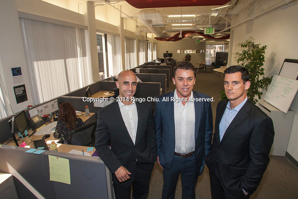 Charles Anderson, left, Blake Johnson, center, and Wesley Lones, right, partners of Enverto Investment Group.<br /> (Photo by Ringo Chiu/PHOTOFORMULA.com)