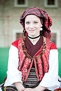 Brodsko kolo, Slavonski Brod, Croatia. Young woman from Vranovci-Bukovlje in traditional folk costume. The Brodsko kolo has been running for over 50 years, and is the oldest folk dancing festival in Croatia. © Rudolf Abraham