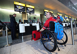 Swimming and archery competitor Jack Cummings at the check-in desk at Heathrow Airport, as the 90-strong team of wounded, injured and sick military personnel and veterans representing the UK depart for the 2017 Invictus Games in Toronto.