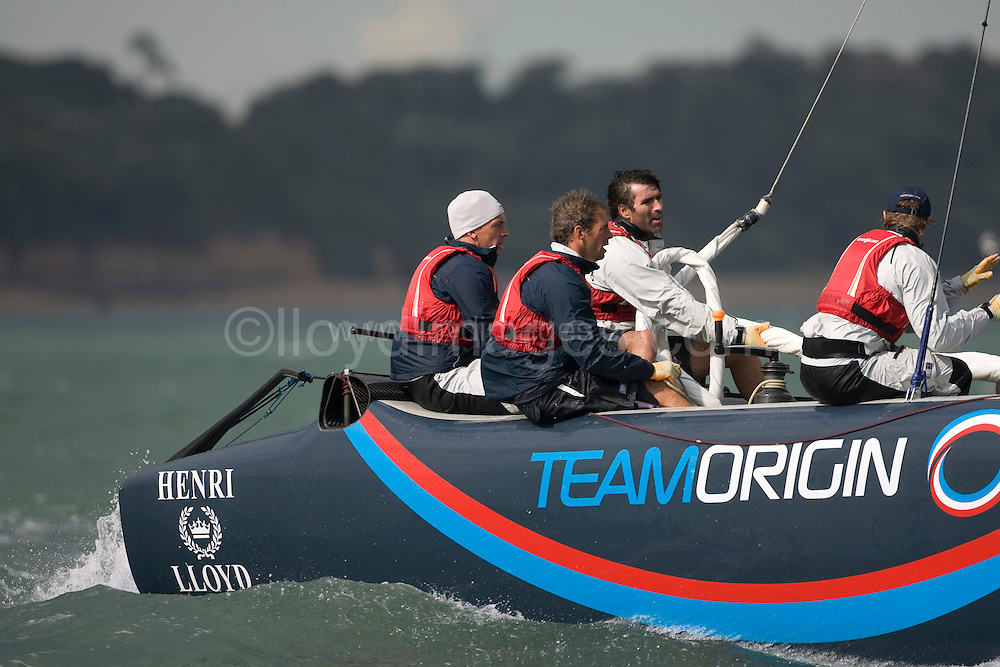 """Day two of Skandia Cowes Week 2008 (Saturday) ..iShares Cup Extreme 40 racing...""""Team Origin"""" carrying on after they righted their capsized extreme 40...Please credit all pictures """"Lloyd Images"""""""