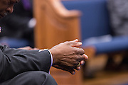 A worshipper prays during a healing service at Charity Missionary Baptist Church April 12, 2015 in North Charleston, South Carolina. Sharpton spoke following the recent fatal shooting of unarmed motorist Walter Scott police and thanked the Mayor and Police Chief for doing the right thing in charging the officer with murder.