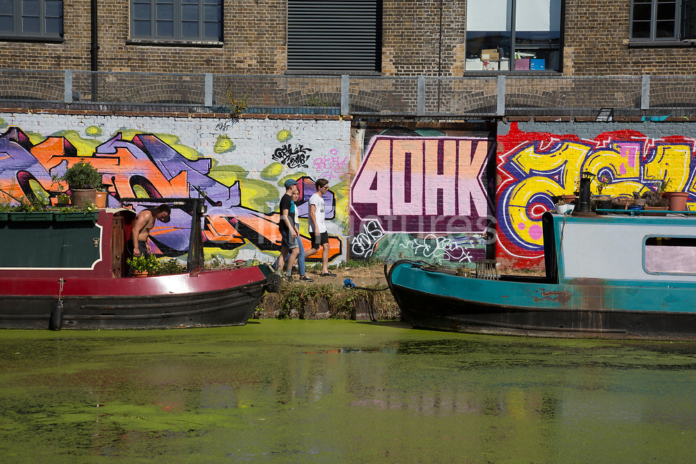 Street art by various artists along the Lea Navigational canal in Hackney Wick, East London, United Kingdom. Street art in the East End of London is an ever changing visual enigma, as the artworks constantly change, as councils clean some walls or new works go up in place of others. While some consider this vandalism or graffiti, these artworks are very popular among local people and visitors alike, as a sense of poignancy remains in the work, many of which have subtle messages.