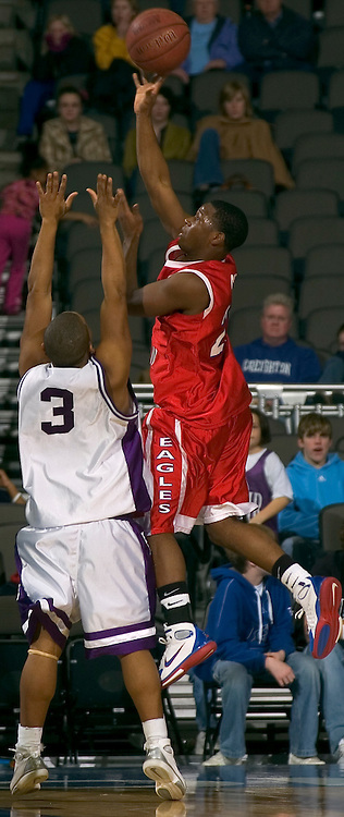 """2/11/06 -- Omaha, NeReserve Christian's Demond """"Tweety"""" Carter  fires a shot over Omaha Central's Ronnell Grixby at The Omaha Shootout, a High School Basketball tournament featuring some of the best prospects at the Qwest Center Omaha...(Photo by Chris Machian/Prarie Pixel Group)."""