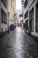 Coronavirus / Covid 19 outbreak, January 28th. 2021. The deserted Salzgasse in the old town, rainy weather, Cologne, Germany.<br /> <br /> Coronavirus / Covid 19 Krise, 28. Januar 2021. Die menschenleere Salzgasse in der Altstadt, Regenwetter,  Koeln, Deutschland.