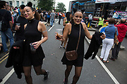 Girls dressed up as black cats. Notting Hill Carnival in West London. A celebration of West Indian / Caribbean culture and Europe's largest street party, festival and parade. Revellers come in their hundreds of thousands to have fun, dance, drink and let go in the brilliant atmosphere. It is led by members of the West Indian / Caribbrean community, particularly the Trinidadian and Tobagonian British population, many of whom have lived in the area since the 1950s. The carnival has attracted up to 2 million people in the past and centres around a parade of floats, dancers and sound systems.