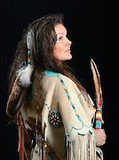 Native American Quapaw in handmade buckskin dress.