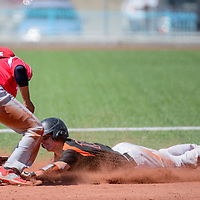 032815       Cable Hoover<br /> <br /> Gallup Bengal Isiah Malcom (12) dives into second base in an attempt to beat the tag from Bernalillo Spartan  D'Alan Sandoval (9) Saturday at the Gallup Sports Complex.