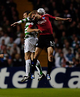Photo: Jed Wee.<br /> Glasgow Celtic v FC Copenhagen. UEFA Champions League, Group F. 26/09/2006.<br /> <br /> Copenhagen's Michael Silberbauer (R) jumps with Celtic's Lee Naylor.