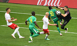 MOSCOW, June 19, 2018  Poland's goalkeeper Wojciech Szczesny (1st R) defends during a Group H match between Poland and Senegal at the 2018 FIFA World Cup in Moscow, Russia, June 19, 2018. Senegal won 2-1. (Credit Image: © Wang Yuguo/Xinhua via ZUMA Wire)