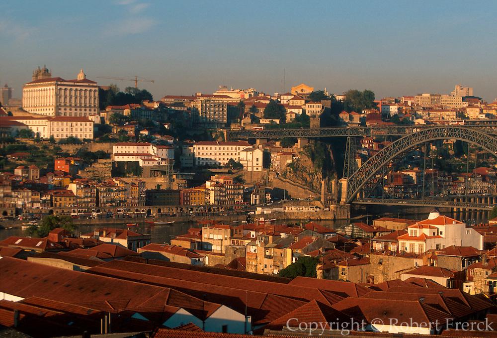 PORTUGAL, NORTH, DOURO RIVER, PORTO skyline of Porto appears across Douro River above the roofs of the Port Wine lodges in Vila Nova de Gaia