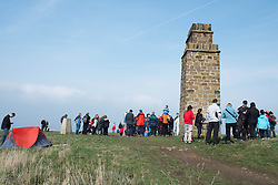 © Licensed to London News Pictures. 29/03/2014<br /> <br /> Eston Hills, Teesside, United Kingdom<br /> <br /> A community group called the Friends of Eston Hills gather at the base of a monument on the top of Eston Nab in Teesside. The group who have recently raised £15000 in just seven weeks to buy the land and return it to public ownership gathered to celebrate on top of the Nab.<br /> <br /> The area will now be returned to public ownership for the first time in hundreds of years and there are plans to raise more funds to create a heritage trail, clean the site up and create a memorial to 375 miners who died when there was an iron mine on the site.<br /> <br /> <br /> Photo credit : Ian Forsyth/LNP