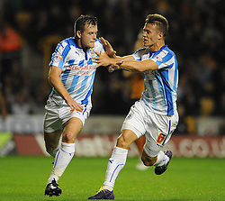 Huddersfield Town's Harry Bunn celebrates his goal with Huddersfield Town's Jonathan Hogg - Photo mandatory by-line: Dougie Allward/JMP - Mobile: 07966 386802 - 01/10/2014 - SPORT - Football - Wolverhampton - Molineux Stadium - Wolverhampton Wonderers v Huddersfield Town - Sky Bet Championship