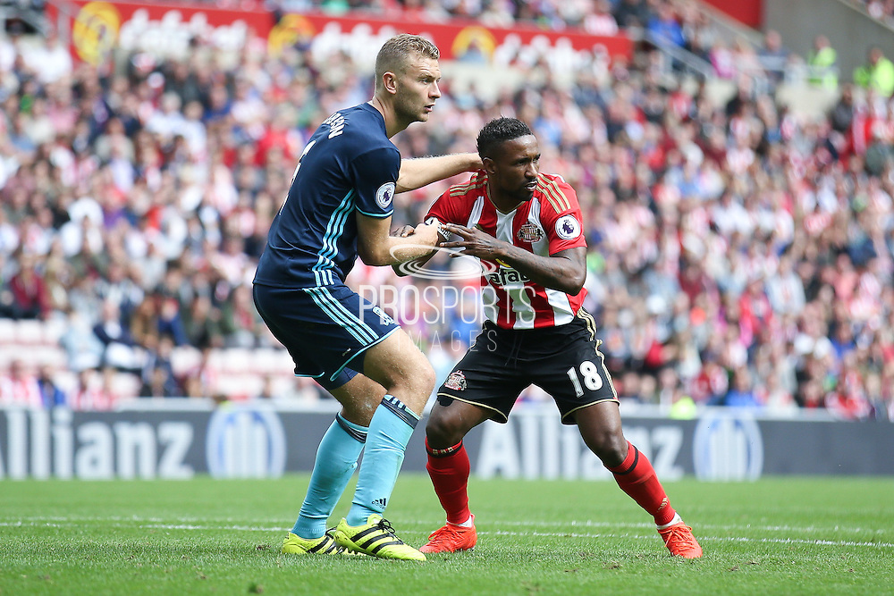 Middlesbrough defender Ben Gibson (6)  keeps a close eye on Sunderland forward Jermain Defoe (18)  during the Premier League match between Sunderland and Middlesbrough at the Stadium Of Light, Sunderland, England on 21 August 2016. Photo by Simon Davies.